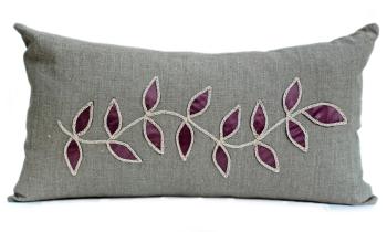 Linen cushion with steel leaf design