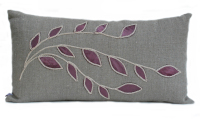 Linen cushion with plum leaf design