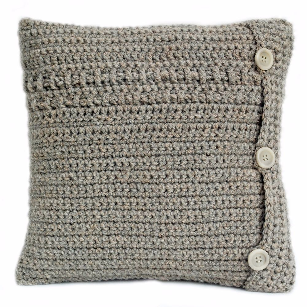 Hand crocheted cushion with woven detail