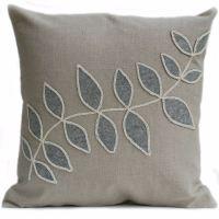 Linen cushion with grey leaf design