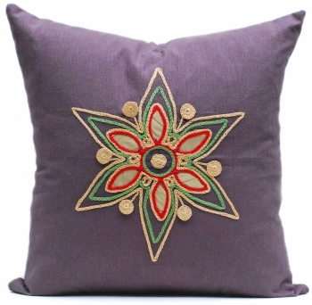Dark linen cushion with gold floral star design