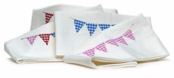 White napkins with appliqued bunting design