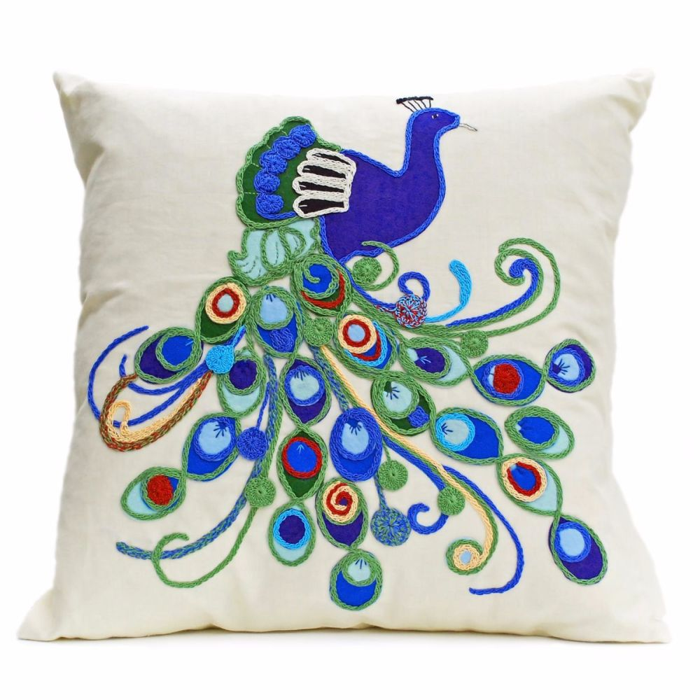 Linen cushion with ornate peacock design