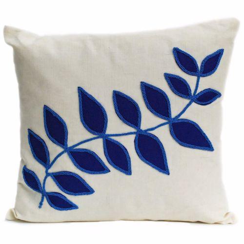 Linen cushion with blue leaf design