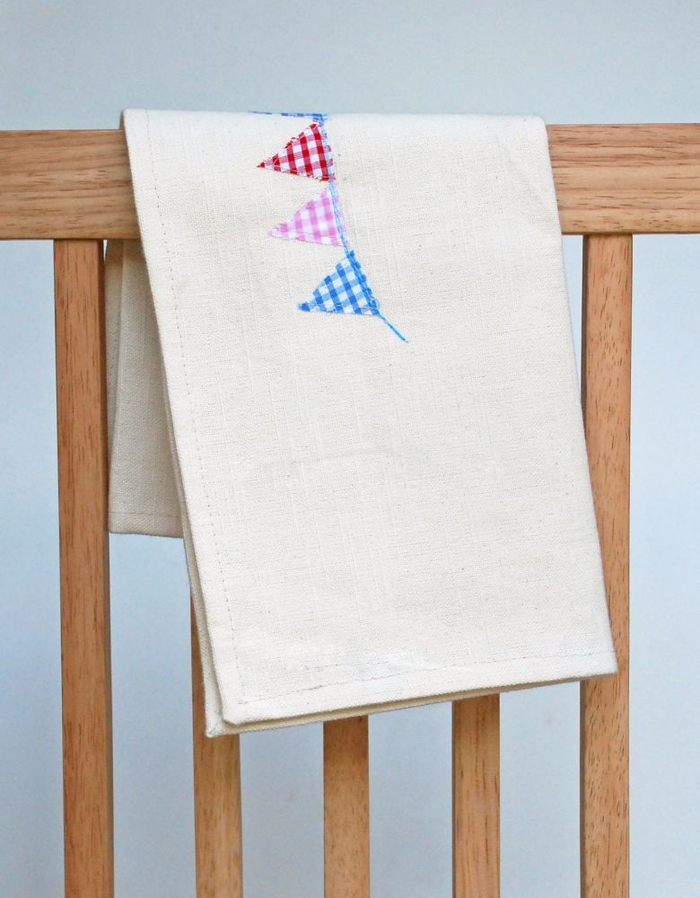Cream cotton tea towel with bunting design
