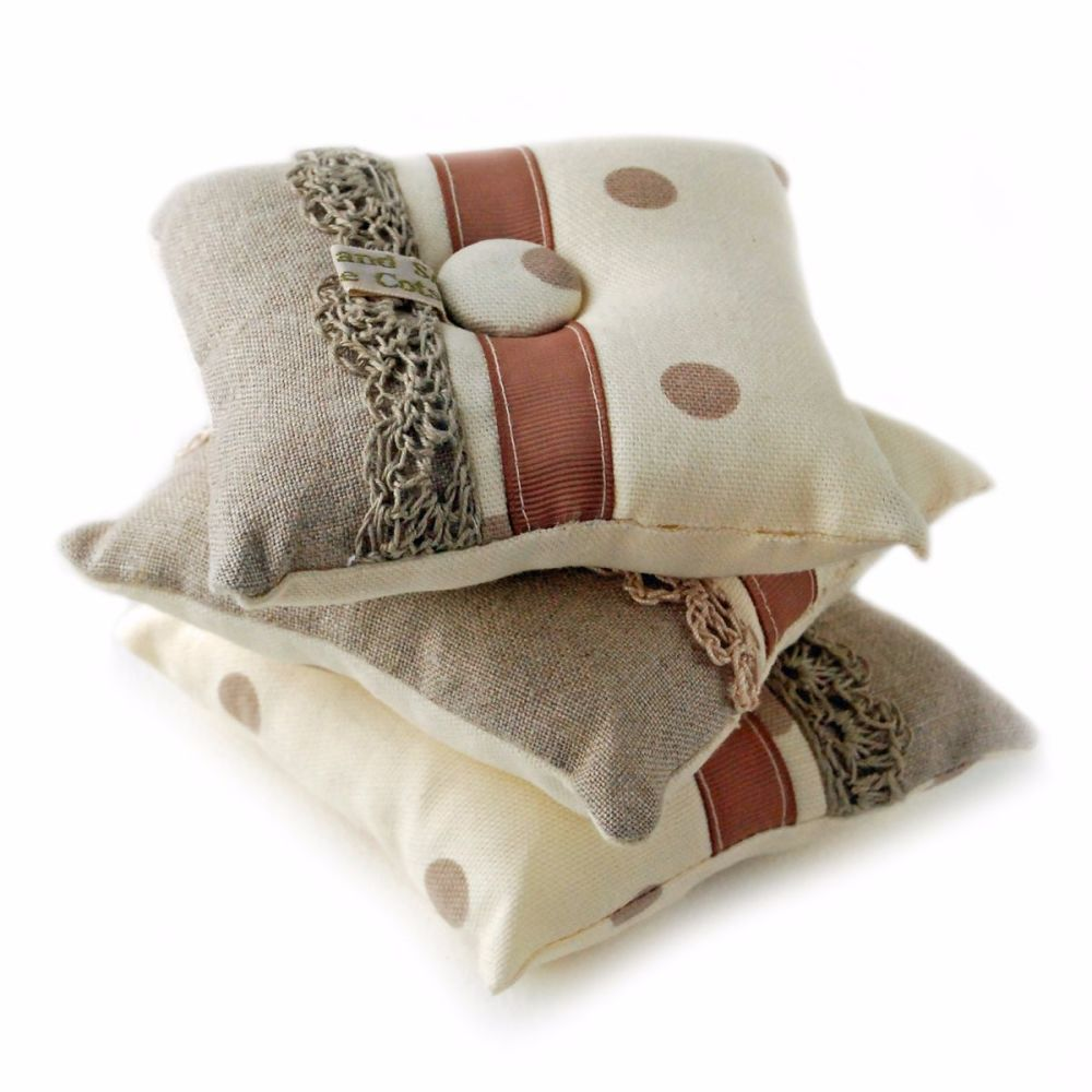 Pin cushion in cream and taupe spots design
