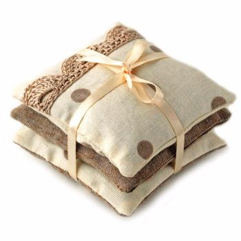 Lavender pillows in cream and taupe spots design