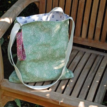 Sage green tote bag with leaves design