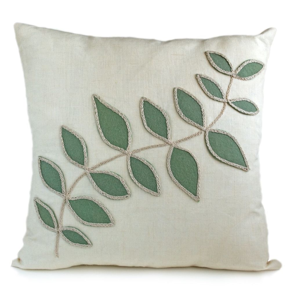 Linen cushion with sage green leaf design