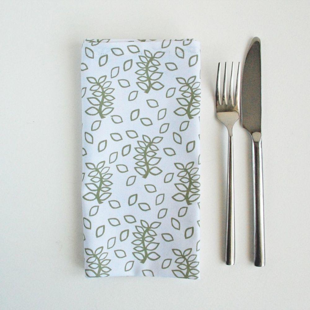 White napkins sage green leaves design