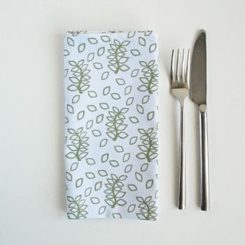 White napkins sage green leaves design