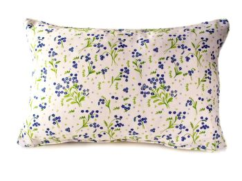 Self piped cushion in Forget-Me-Not design