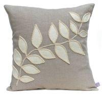 Linen cushion with cream leaf design