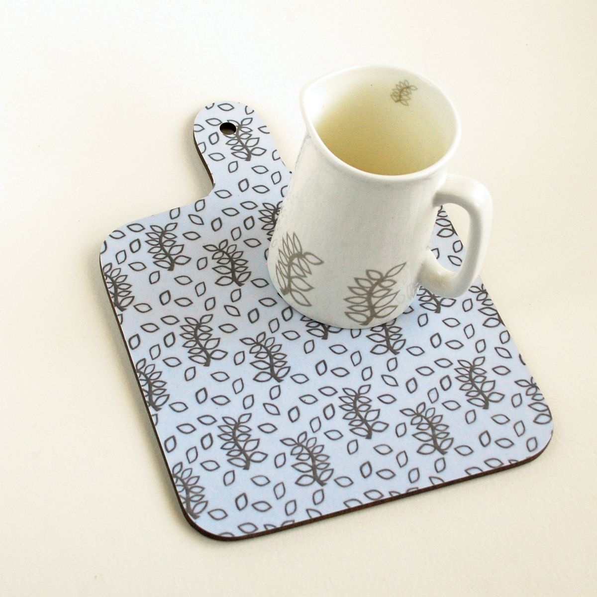 Ivory leaves chopping board and half pint jug