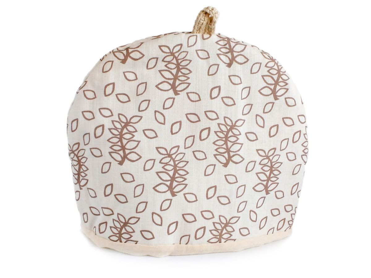 Ivory leaves linen and cotton mix tea cosy with hand crocheted tab
