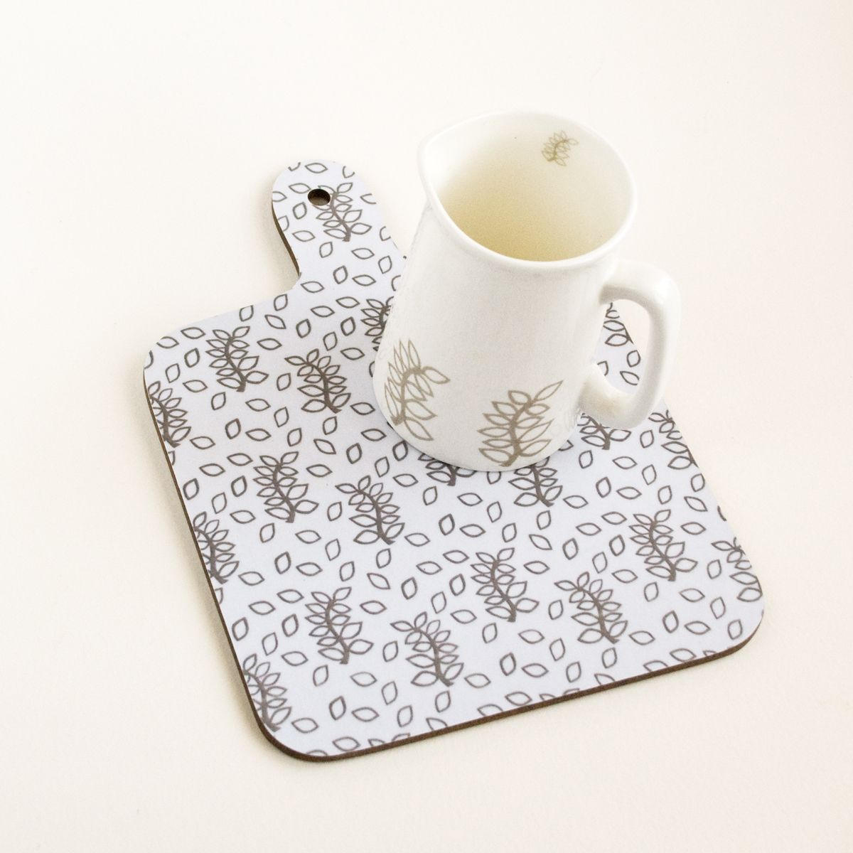 Ivory and taupe leaves chopping board
