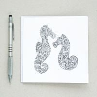 Floral seahorses design greetings card