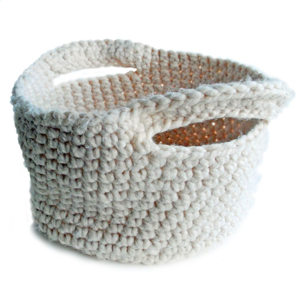 Hand crocheted basket with handles