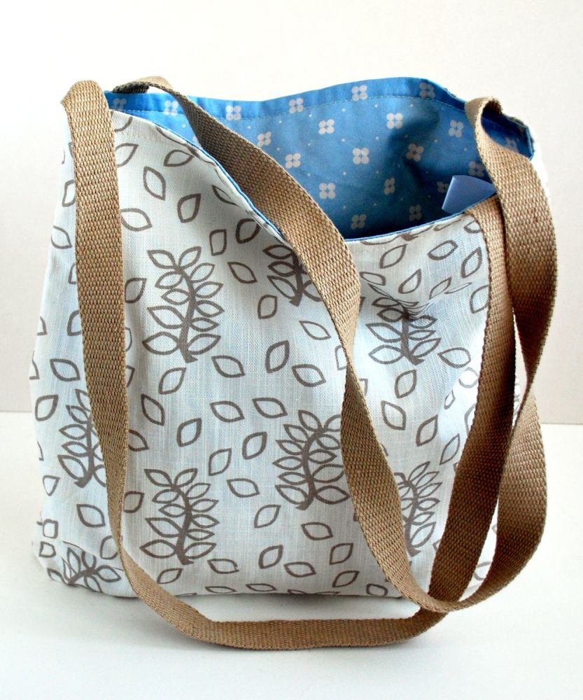Ivory leaves tote bag with fabric fob