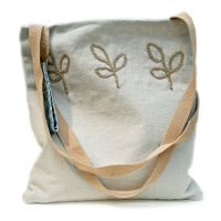 Handmade linen tote bag with crocheted motifs