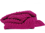 Chunky crocheted throw in cerise
