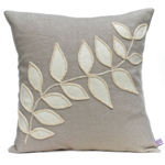 Linen cushion with cream leaf design