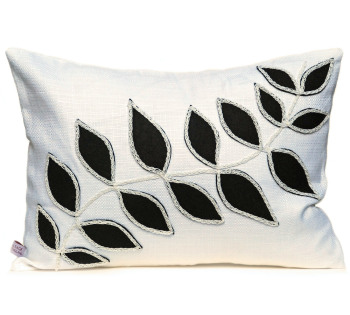 White cushion with black leaf design