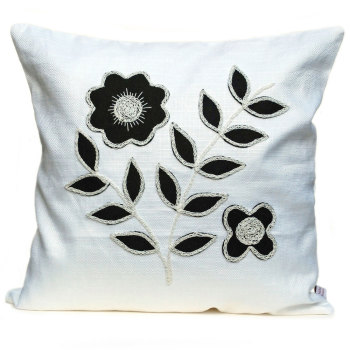 Monochrome cushion with black floral leaf design