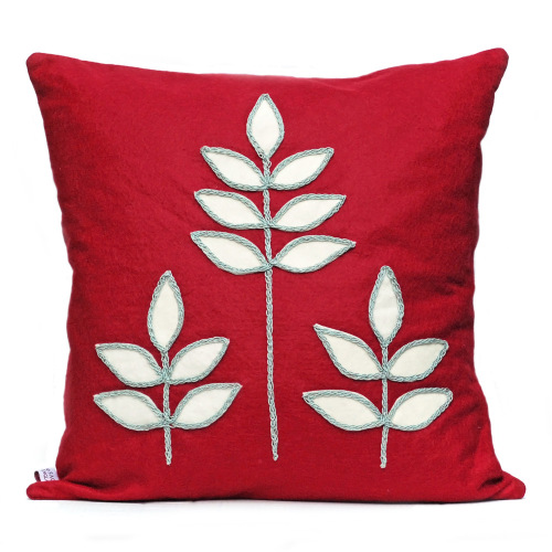 Red wool felt cushion with abstract leaf design