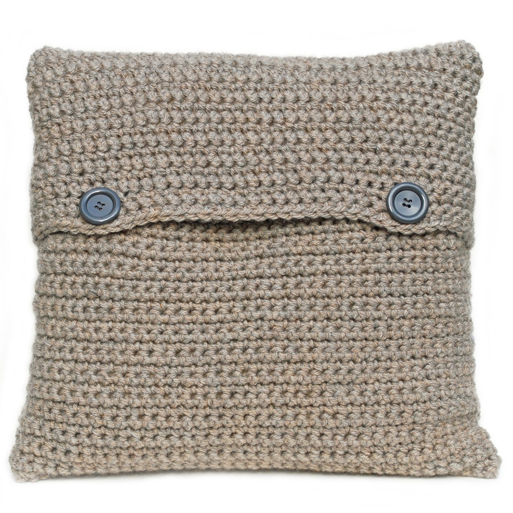 Hand crocheted cushion in natural fawn