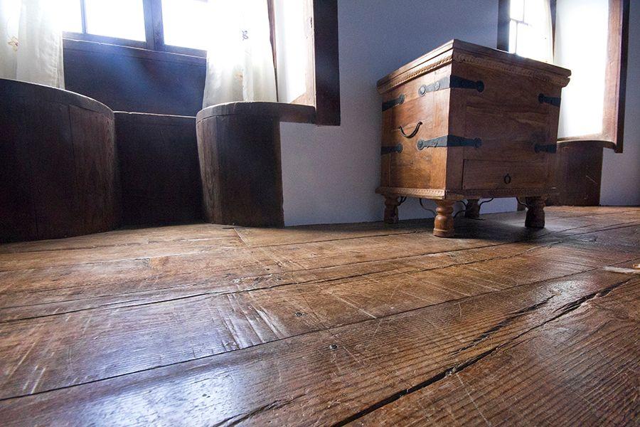 Casita bedroom with original tea wood floor