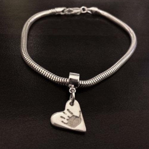 Charm on snake/pandora style bracelet