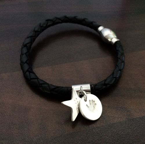 Charm on leather bracelet
