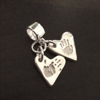 Charm on charm carrier or clasp