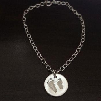 Charm on cable link bracelet