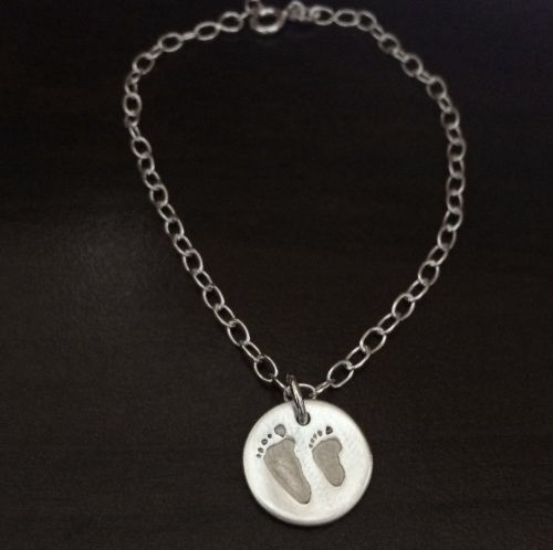 Charm on cable link bracelet