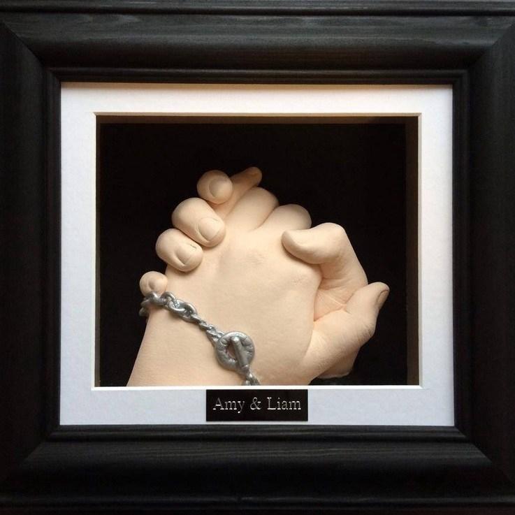 holding hand framed