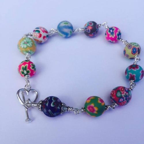 Colourful Floral Fimo bead handcrafted Rosary Bracelet