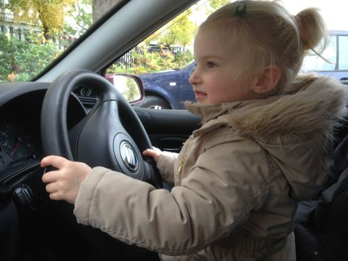 Happiness with all the family on a day out - bella pretending to drive the car