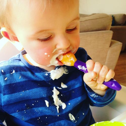 reuben decides to feed himself with a spoon age one - lylia rose lifestyle
