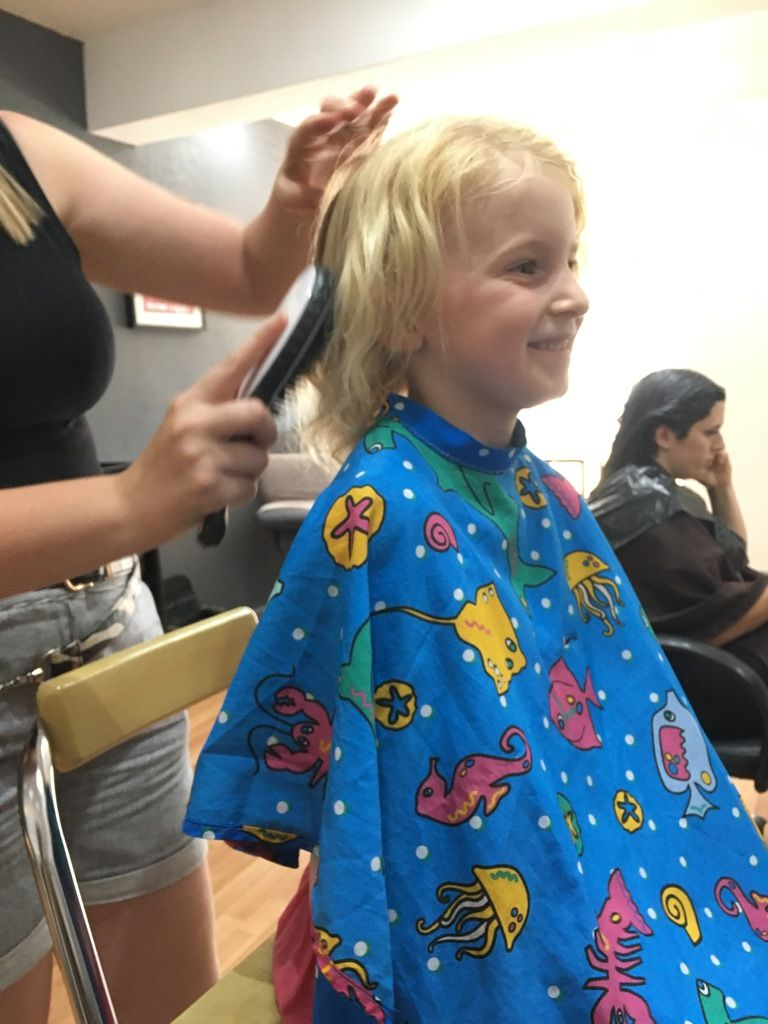 photo of bella getting her hair cut for the first time age 6 for blog post