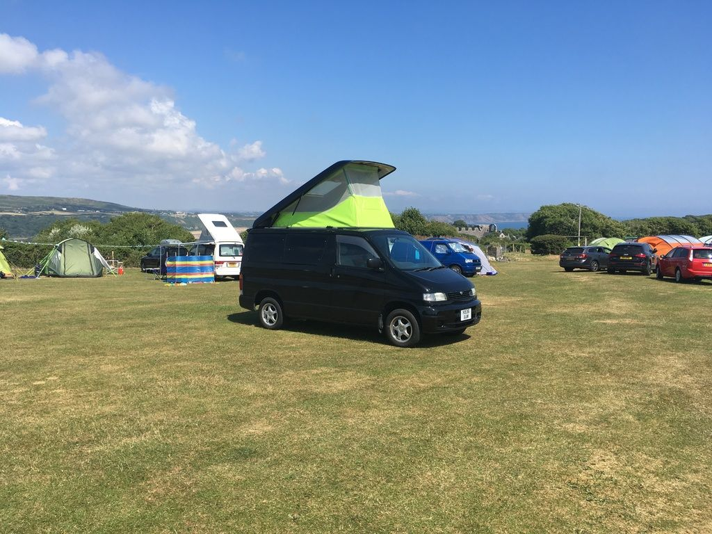 photo of new mazda bongo with pop top up in camping site in oxwich bay devo