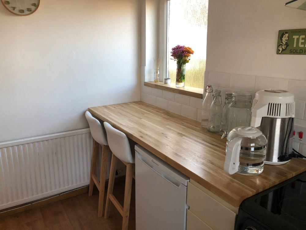kitchen worktop and bar stool breakfast area to cover side door we never use