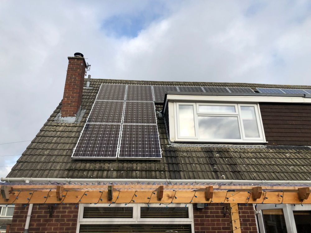 How we reduce our bills using renewable energy - photo of solar panels on o