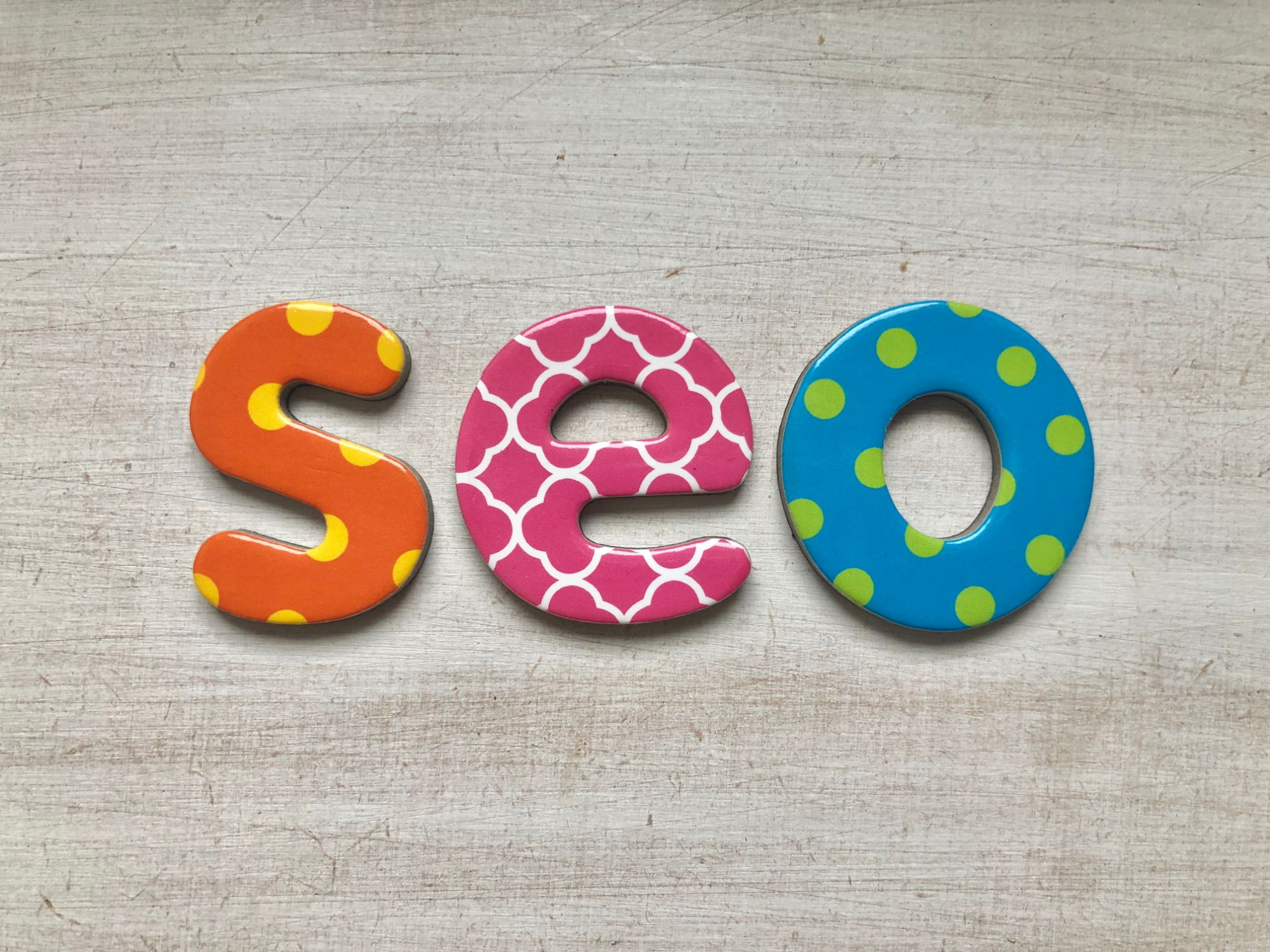Free stock images for money bloggers blog -alphabet lettering letters white background colourful says  'seo'