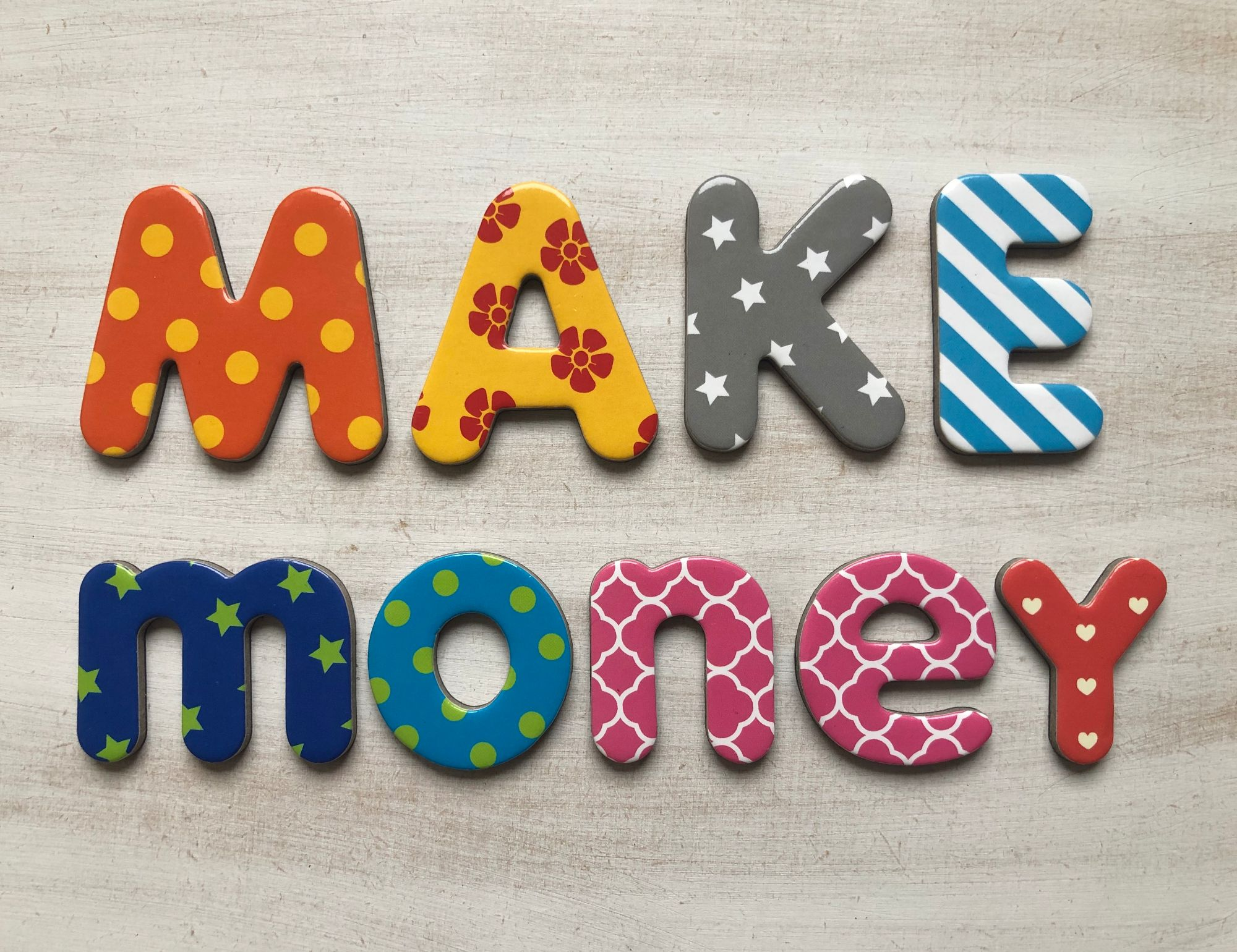 Free stock images for money bloggers blog -alphabet lettering letters white background colourful says 'make money'