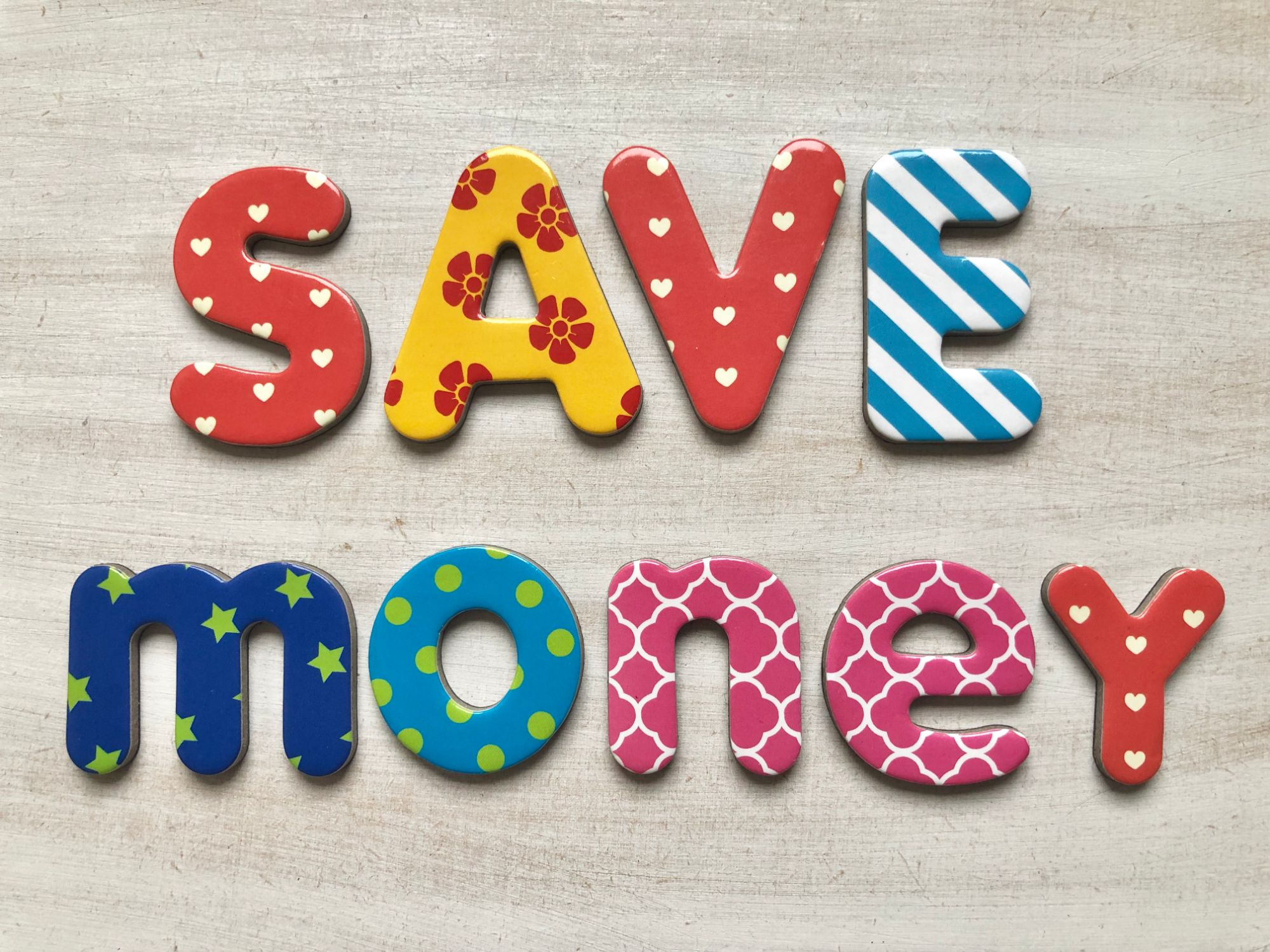 Free stock images for money bloggers blog -alphabet lettering letters white background colourful says 'save money'