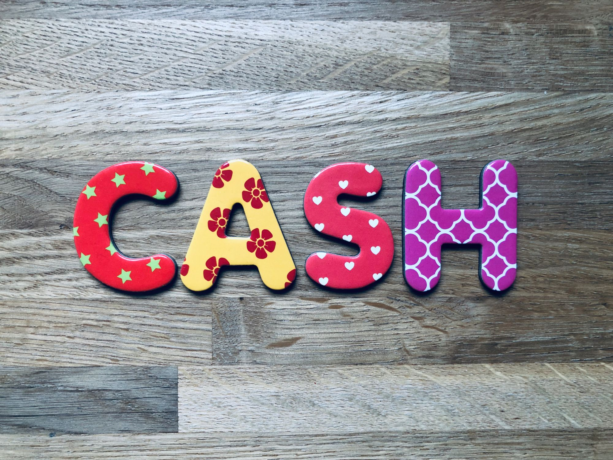 Free stock images for money bloggers blog wood background 'CASH' cash alphabet lettering letters colourful budget spending