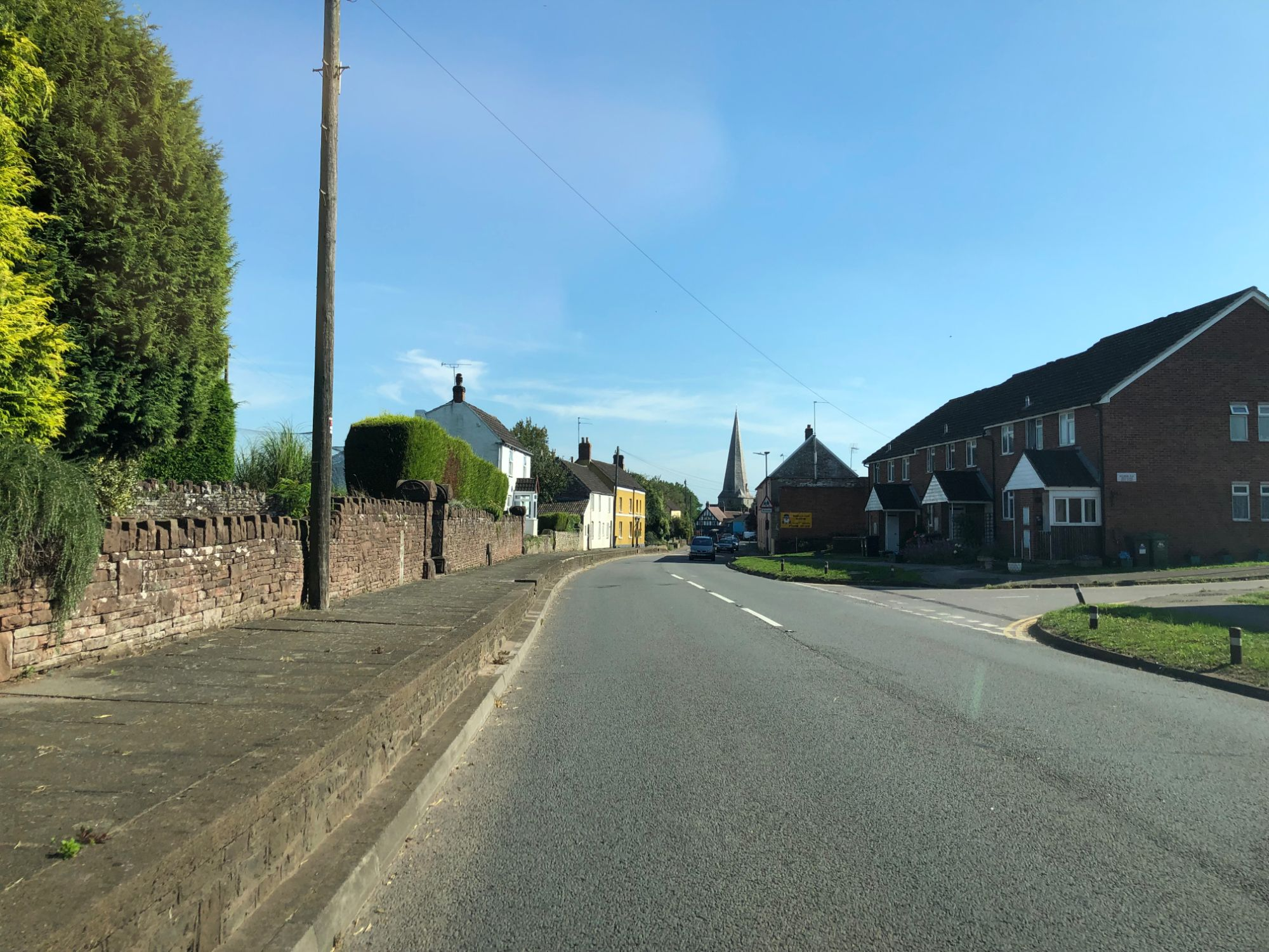 free stock image photo uk road village town blue sky