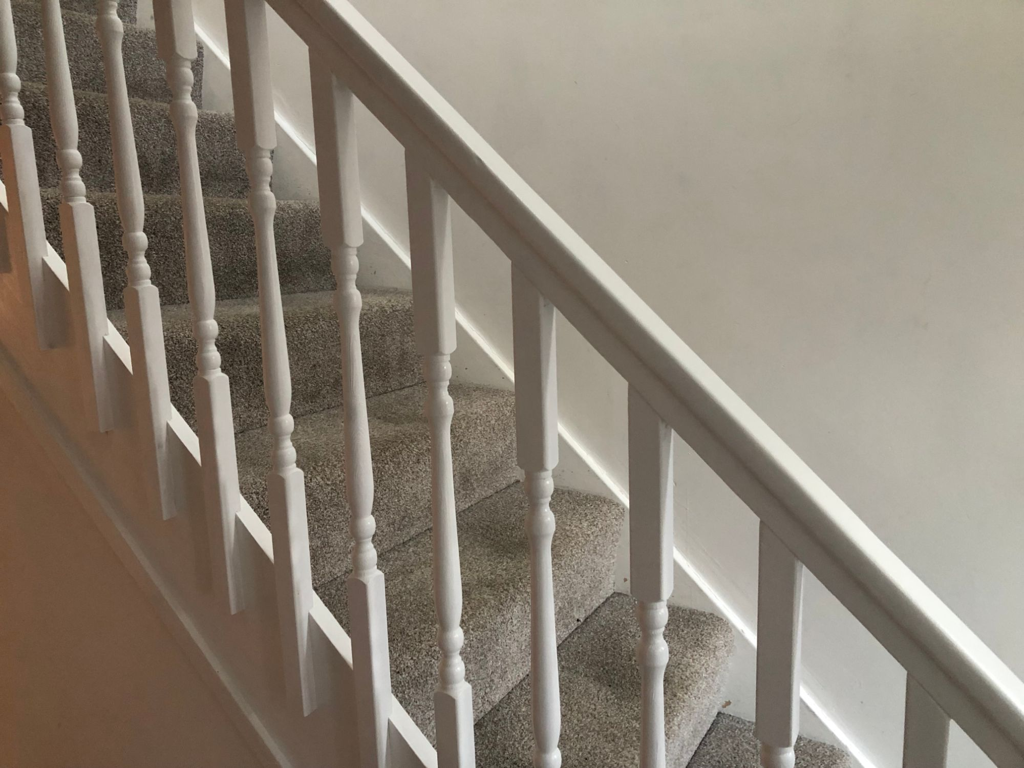 Free stock photo new spindles DIY white paint staircase